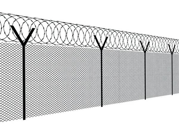 A line of razor wires are installed on the top of chain link fencing.
