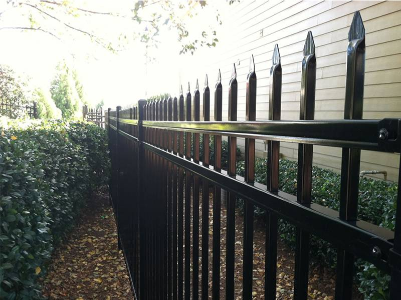 Black ornamental steel tubular fence with spear top.