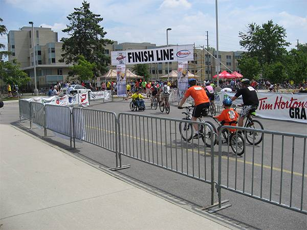 Crowd control barriers are surrounding the bike racks in cycle racing.