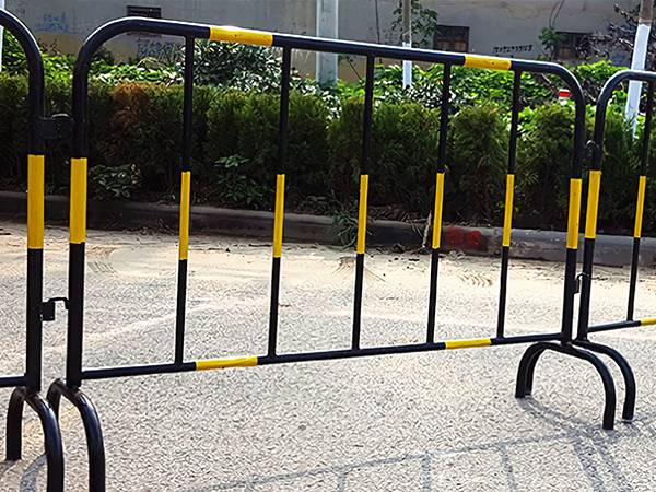 Black steel barricades are attached with yellow reflective sheet.