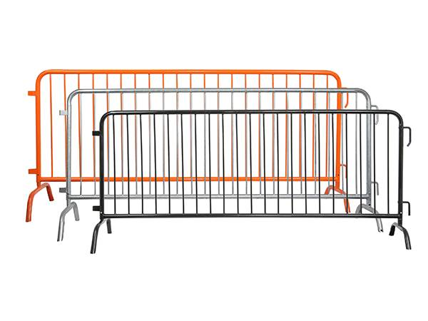 A hot dipped galvanized, an orange and a black steel barricade on white background.