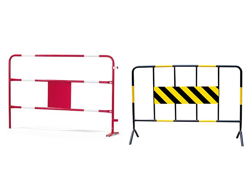A red and a black barrier with reflective sheets on the white background.