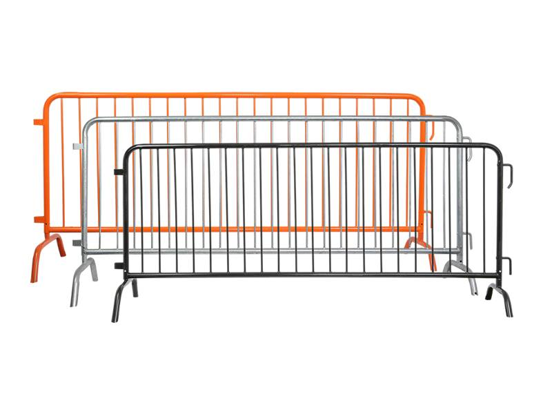 A silver hot dipped, a black and an orange powder coating steel barricades on white background.