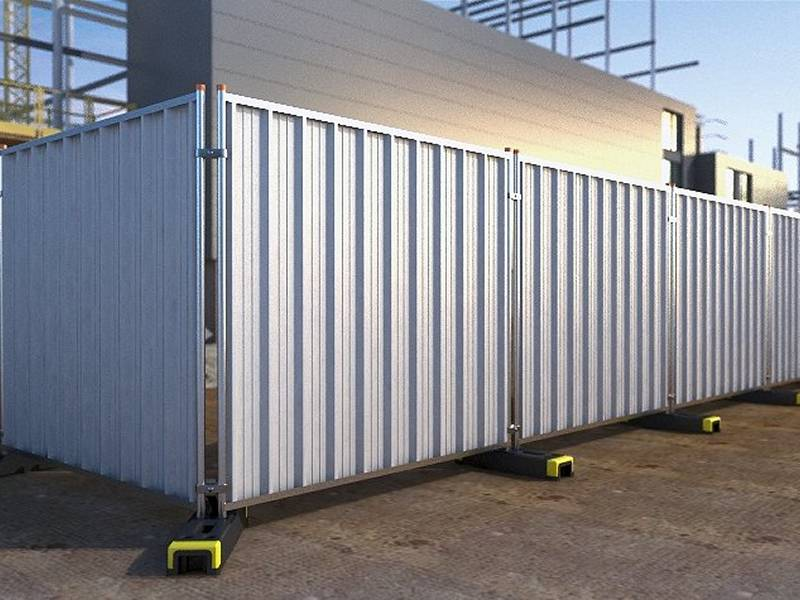 Hoarding panel system with galvanized frame and rubber feet on ground.